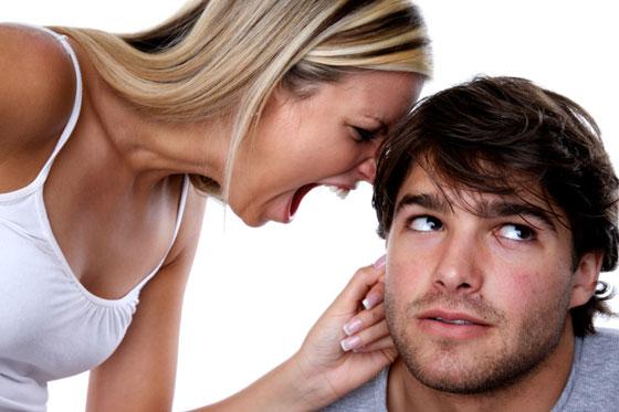 woman-shouting-in-a-mans-ear